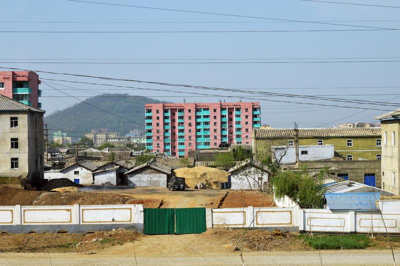 North Korea. Kaesong. Kaesong, North Korea - May 5, 2019: Outskirt of Kaesong. Kaesong Industrial Region. Dwelling houses and construction site royalty free stock image