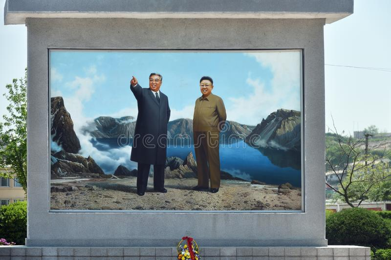 North Korea. Kaesong. Kaesong, North Korea - May 5, 2019: Propaganda panel with portraits of former leaders  Kim Il Sung and  Kim Jong Il on the city street royalty free stock photography