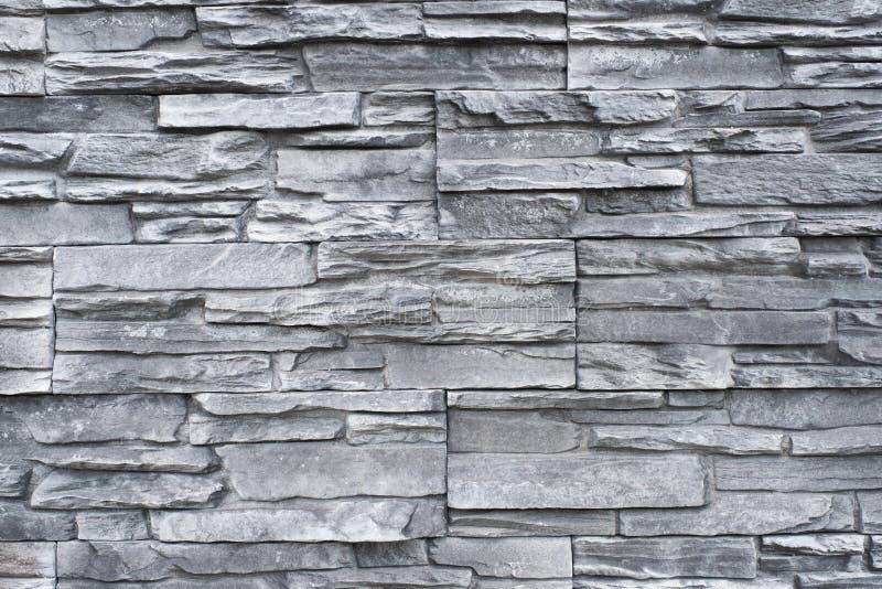 Kafelkowy naturalny kamiennej ściany tło - granit kamienna tekstura obraz stock