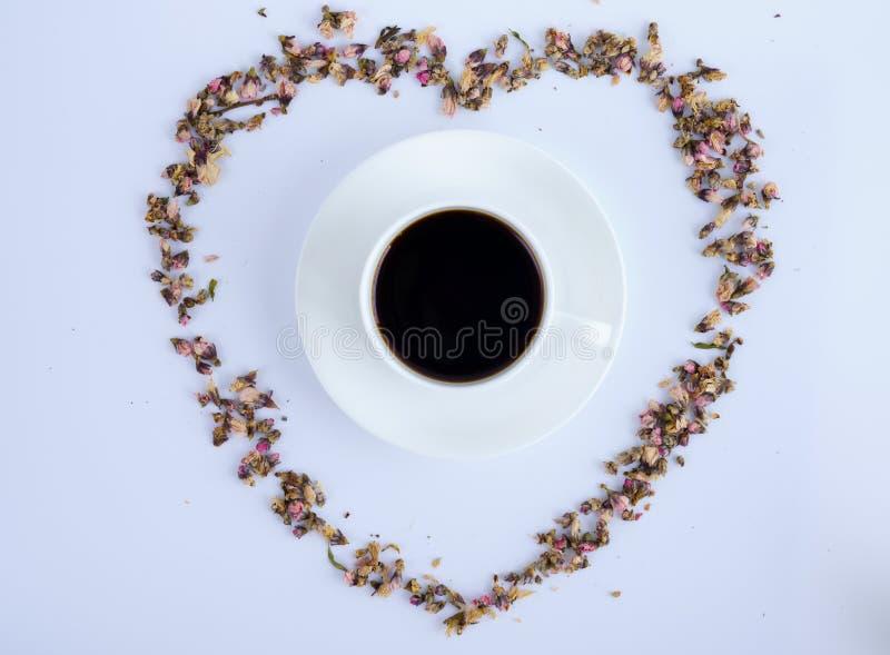 Kaffe och blommor royaltyfri foto