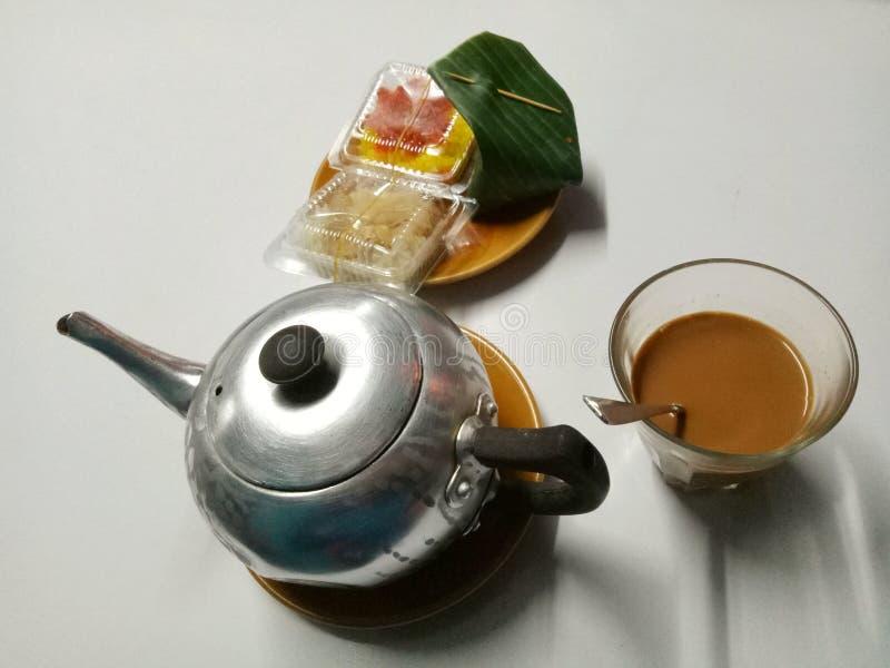 Kaffe och godis royaltyfri bild