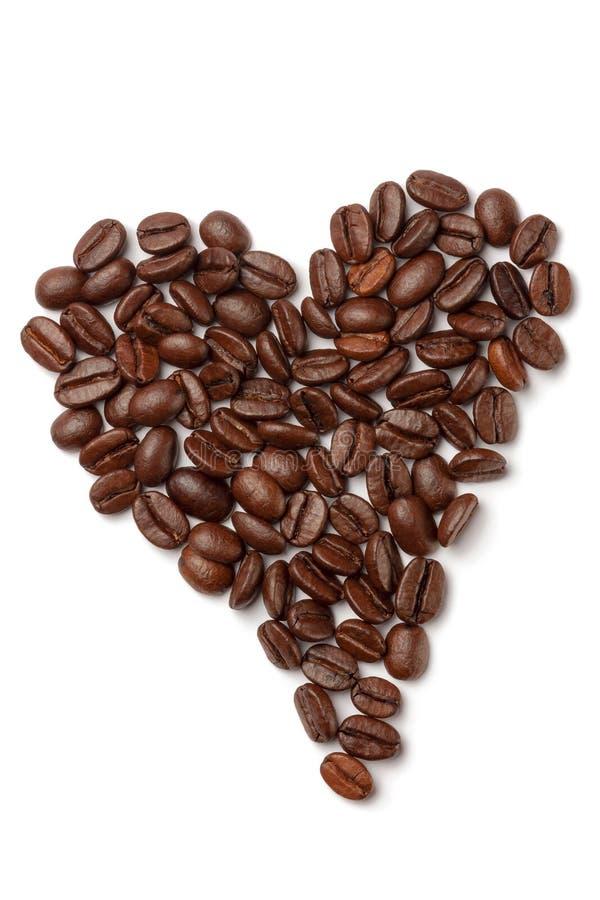 Kaffebönor i form av hjärta royaltyfri foto