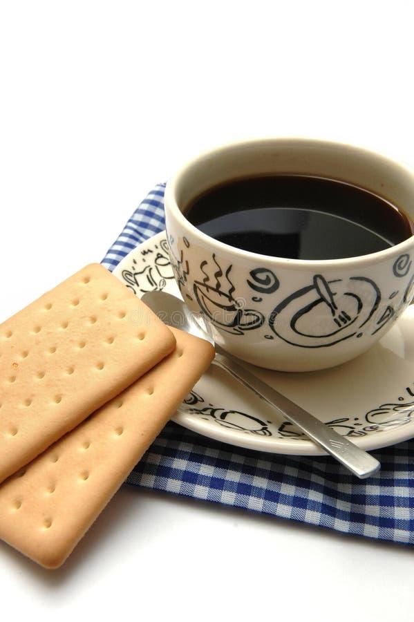 Kaffee und Biskuit stockfotografie