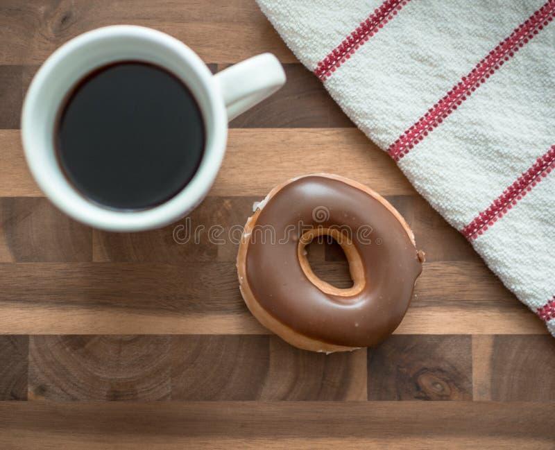 Kaffee und Donut stockbilder