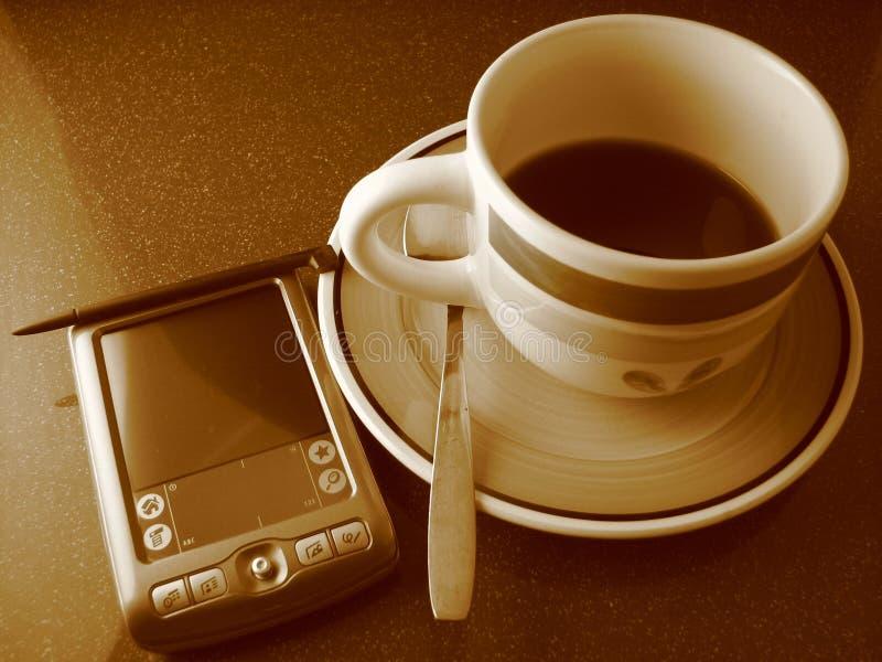 Kaffee und PDA stockfotos