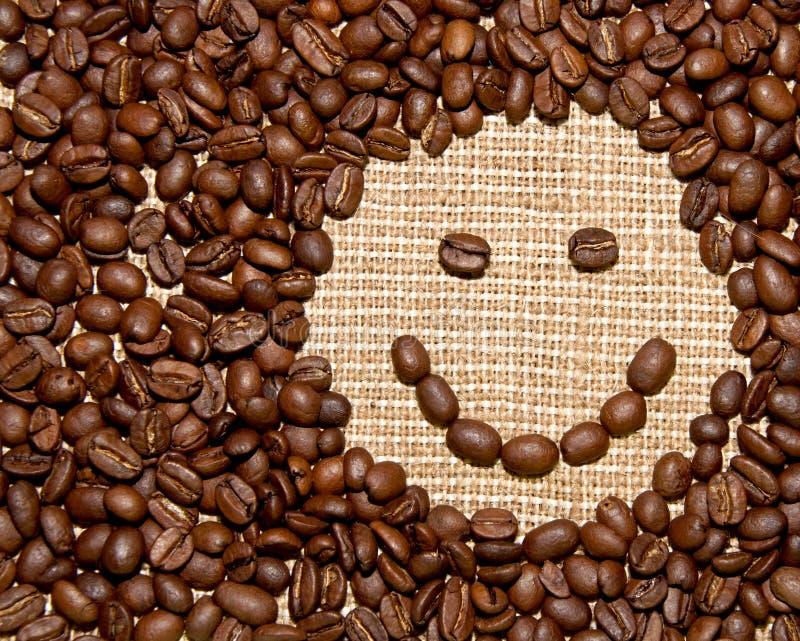 Kaffeebohnelächeln stockfoto