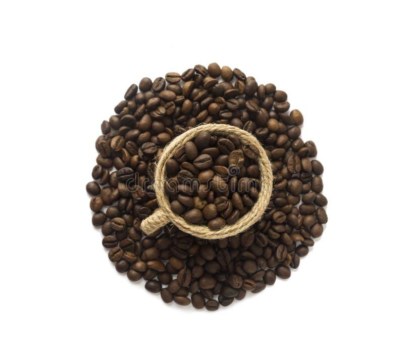 Kaffeebohnen getrennt auf weißem Hintergrund Kaffeehintergrund oder Beschaffenheitskonzept Kaffeebohnen mit Kopienraum für Text a lizenzfreies stockfoto