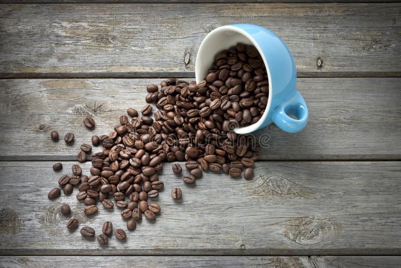 Kaffeebohnen höhlen Hintergrund lizenzfreies stockfoto