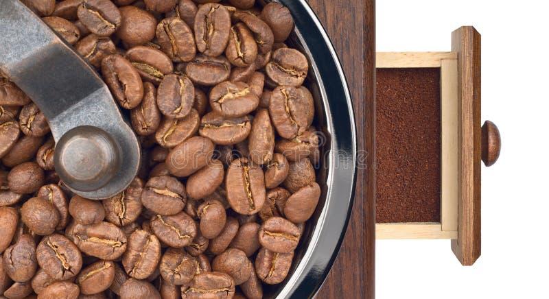Kaffeeschleifer mit Bohnen und Grundnahaufnahme lizenzfreie stockfotografie