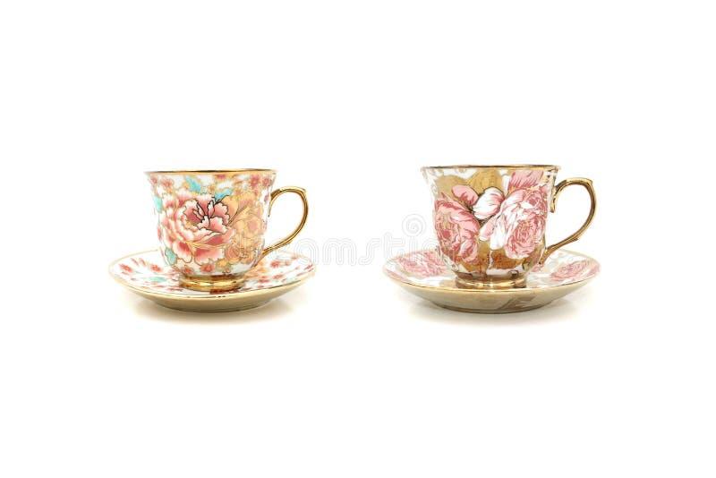 Kaffeetasse-Blumenmuster lizenzfreies stockbild