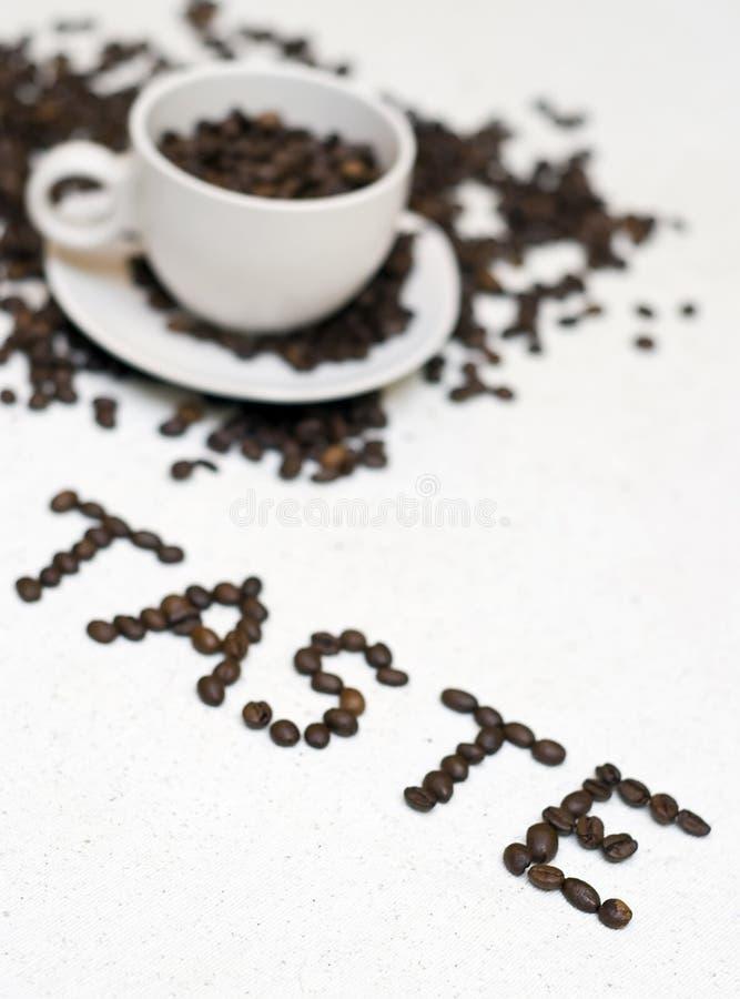 Kaffeetassetext - ?Geschmack? stockfoto