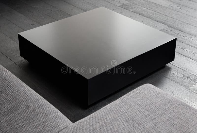 Kaffeetisch des schwarzen Quadrats lizenzfreies stockbild