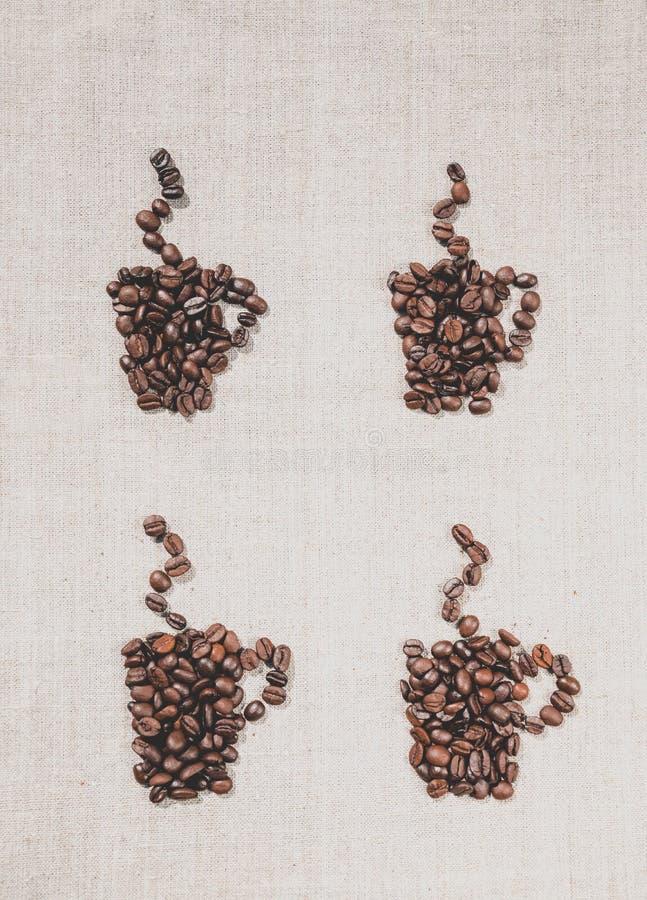 Kaffekoppar och linne dekorativ bakgrund royaltyfria foton