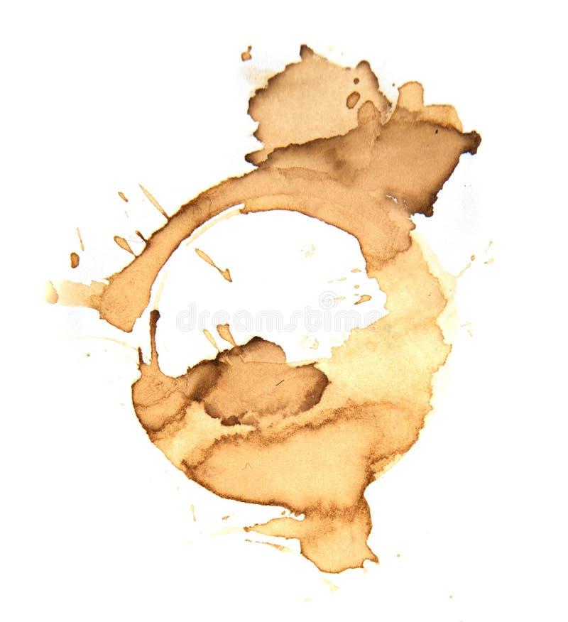 Kaffekoppen ringer på en vit bakgrund arkivfoton