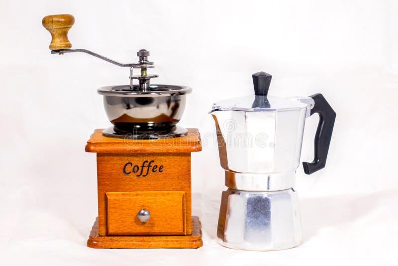 Kaffekvarn och kokkärl, arkivbild