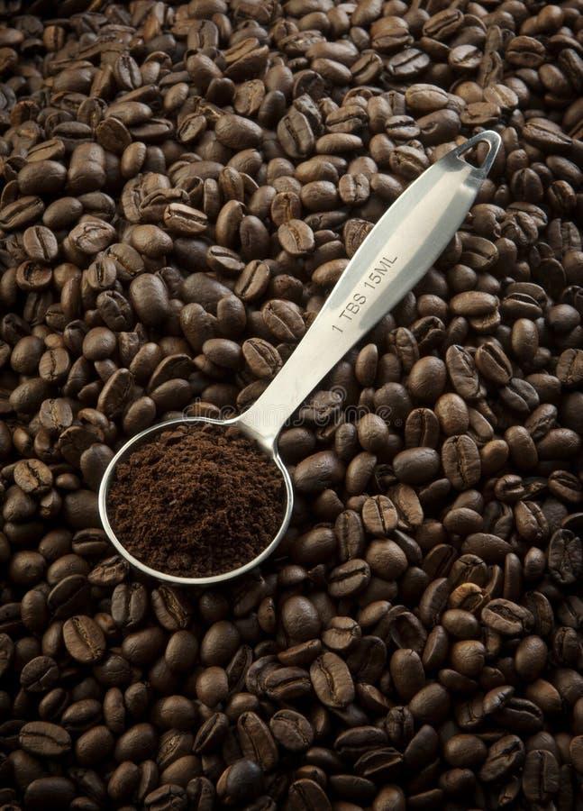 Kaffesked på frö fotografering för bildbyråer