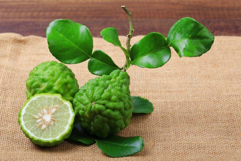 Kaffir lime or bergamot. On sack background royalty free stock photo