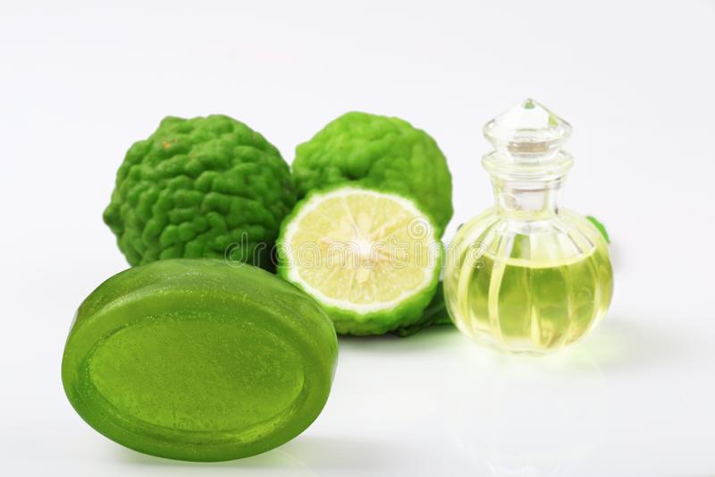 Kaffir lime or bergamot soap with aromatic spa of bottles essential oil isolated royalty free stock image