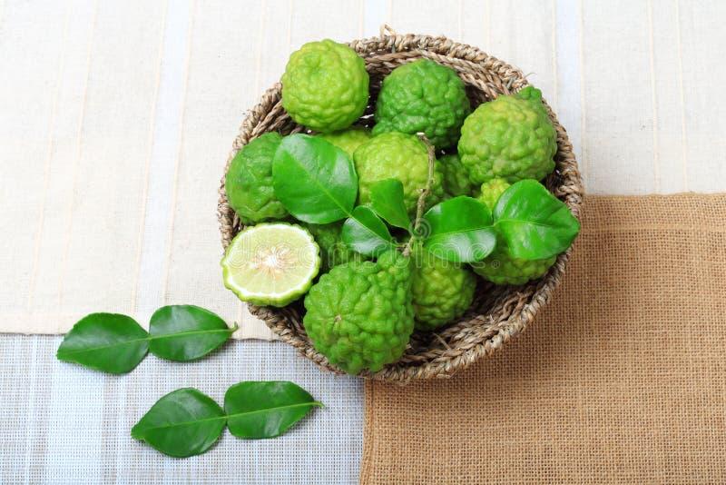Kaffir lime or bergamot. Top view of kaffir lime or bergamot on sack background stock image