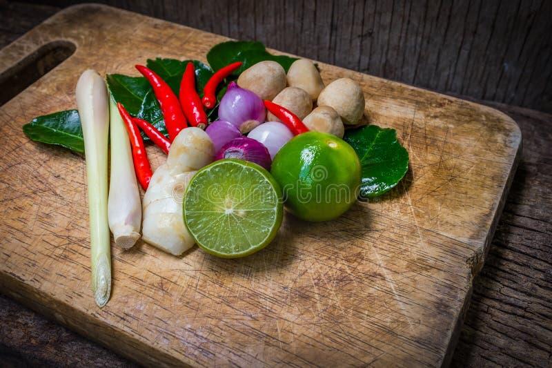 Kaffir lime leaf, lemon, lemongrass, galangal, chili, onions and royalty free stock photo