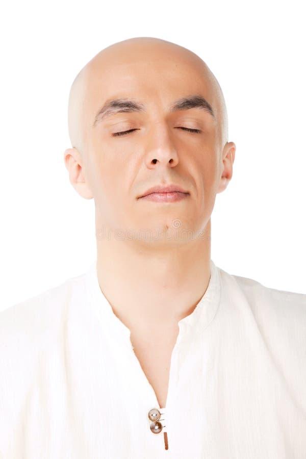 Kahle männliche Meditation des Gesichtes stockfotos