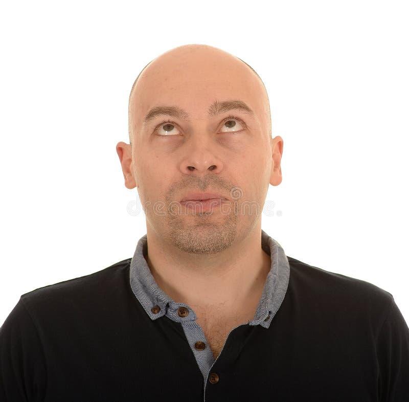 Kahler Mann, der oben schaut stockfotografie
