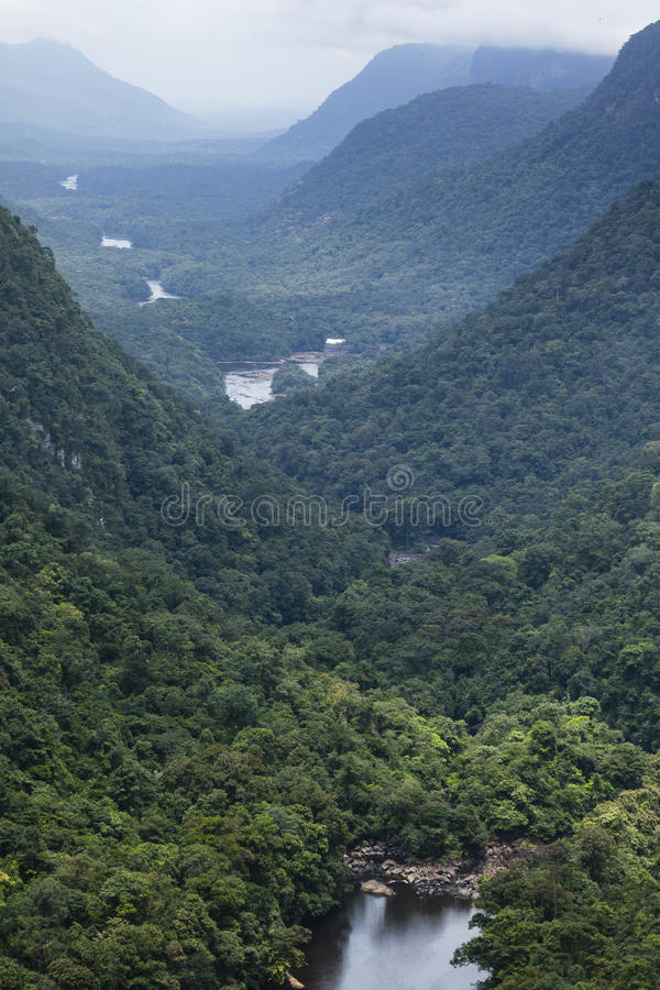 The Kaieteur waterfall valley, mountains and forest stock photos