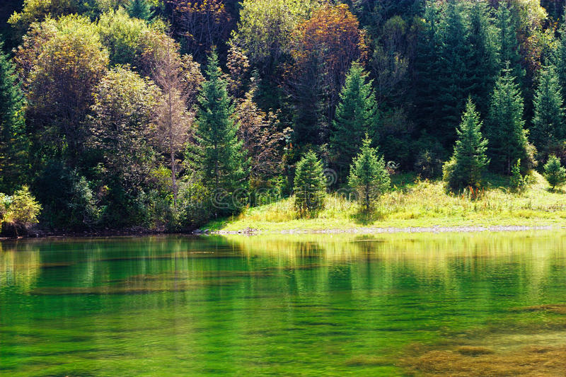 Kaindy green Lake in Tien Shan mountain, Kazakhstan. Autumn. Kaindy Lake in Tien Shan mountain, Kazakhstan. Autumn stock photography