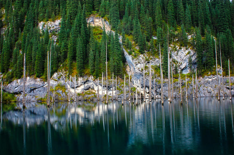 Kaindy Lake in Tien Shan mountain. Kazakhstan. Reflections on water stock images