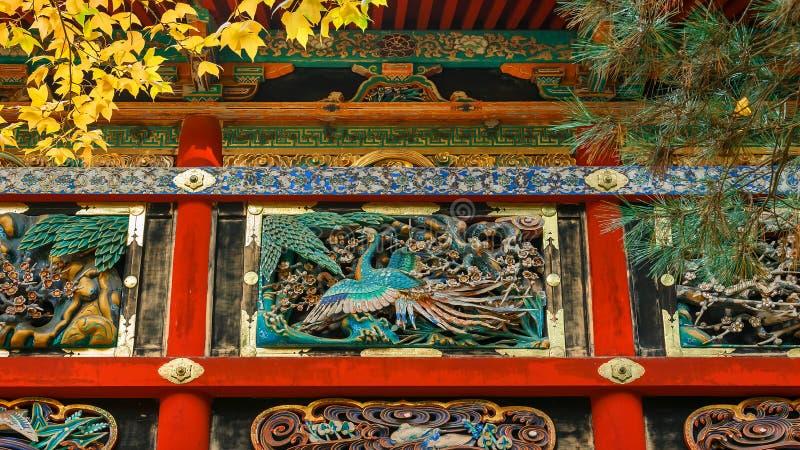 Kairo - väggen av den Yomeimon porten på dengu relikskrin i Nikko, Japan arkivfoto