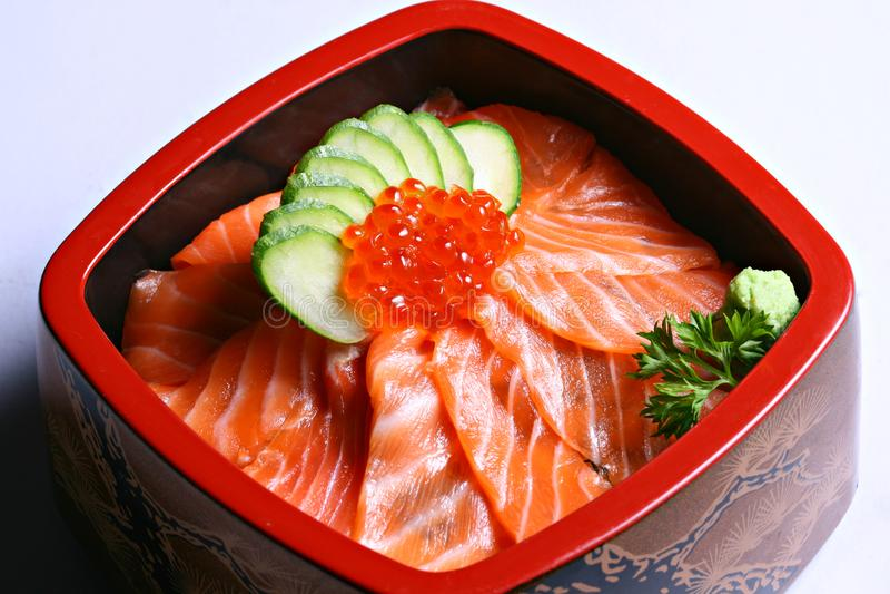 Kaisen Salmon Donburi Fresh Salmon. And Crab sticks and ikura roe topped on rice royalty free stock image