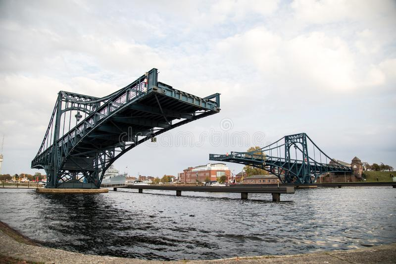Kaiser-Wilhelm-Bridge with open north side is a rotatable steel car bridge and landmark in Wilhelmshaven Germany stock photography