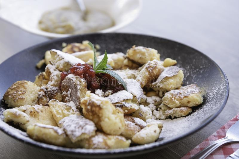 Kaiserschmarrn with apple sauce and cranberries jam royalty free stock photo