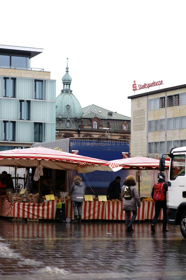 Weekend market Kaiserslautern. Kaiserslautern, Germany - January 26, 2019: Visitors to the market in Kaiserslautern make weekend shopping at fruit and vegetable royalty free stock photo