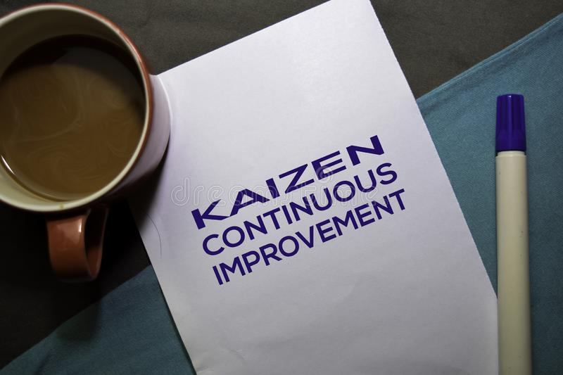 KAIZEN. Continuouse Improvement text on the paper isolated on office desk background. Japanese Concept stock photo
