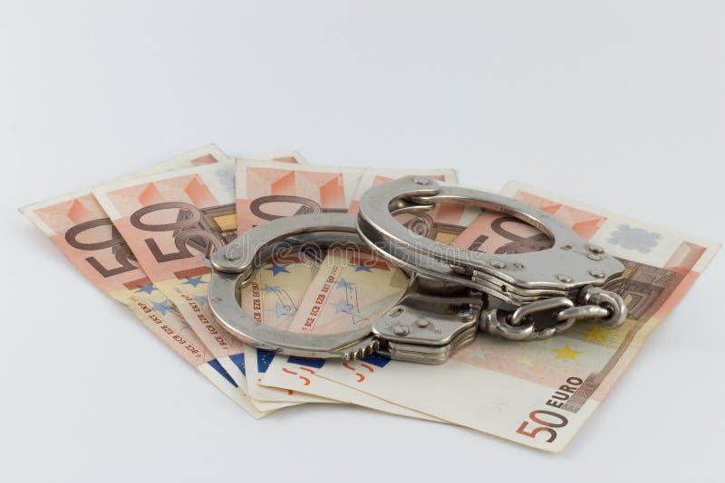 Kajdanki na pieniędzy rachunkach zdjęcie royalty free