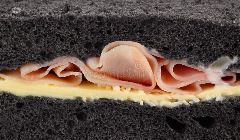 Kaka bröd med skinkaslut upp arkivfoto