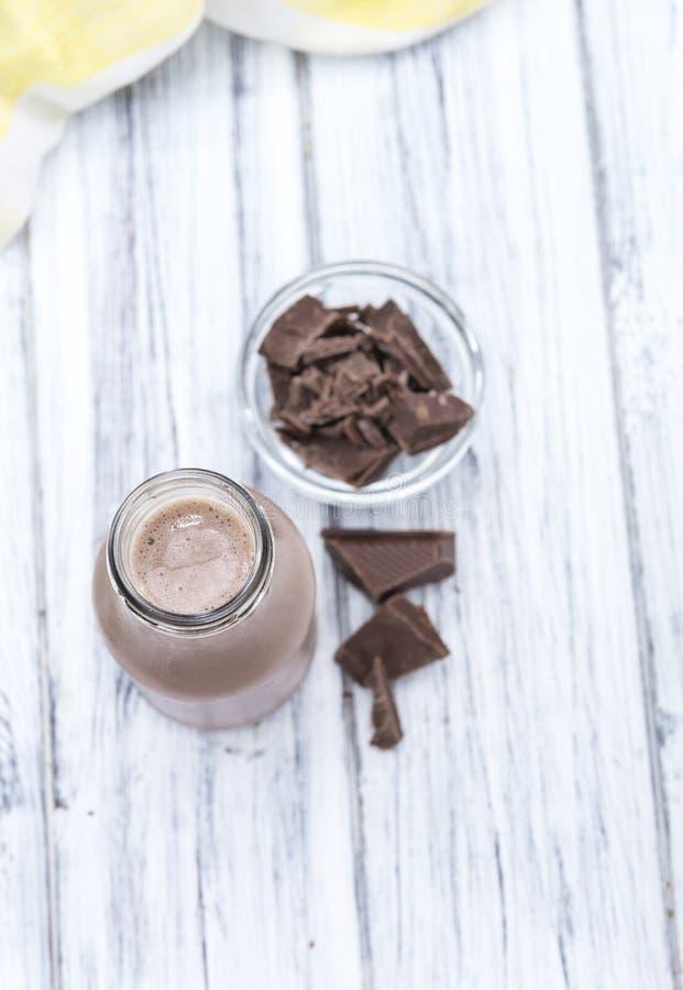 Kakao in einer kleinen Flasche lizenzfreies stockbild