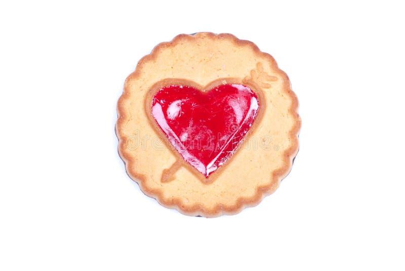Kakor i form av den isolerade hjärtan till valentin dag arkivfoto