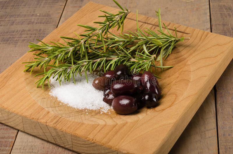 Kalamata olives and rosemary being prepared stock photo