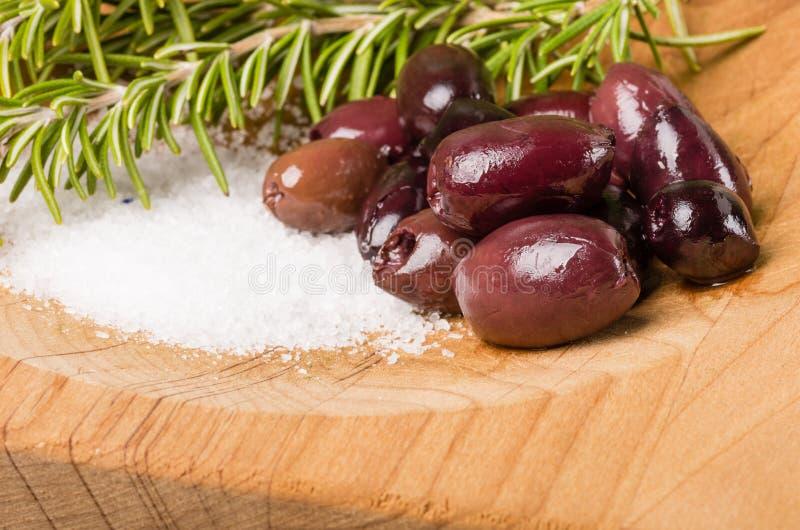 Kalamata olives and rosemary being prepared stock photos