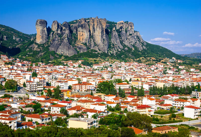 Kalambaka, Greece. Panorama of Kalambaka city with rocy mountains of Meteora, the landmark of six monasteries in Greece stock images