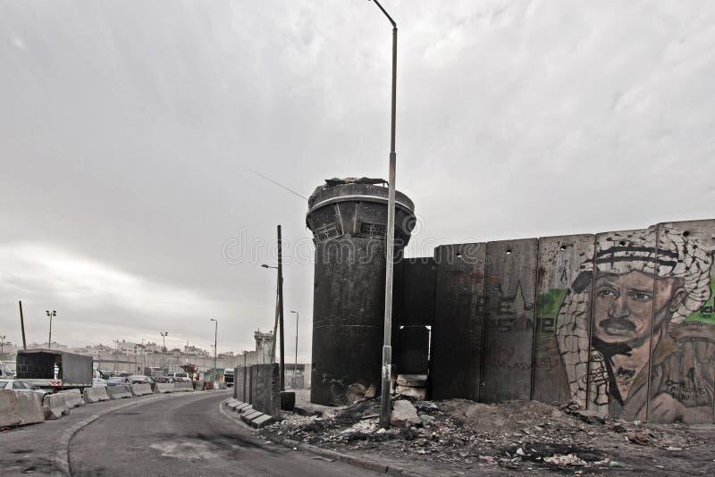 Kalandia Checkpoint in Ramallah. With grafitti of Yasser Arafat royalty free stock images