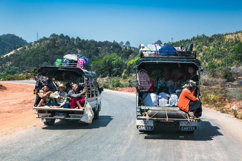 Burmese people on the light truck in Kalaw, Myanmar. KALAW, MYANMAR-MARCH 5,2017: Burmese people on the light trucks in Kalaw on March 5, 2017, Myanmar.They are royalty free stock photos