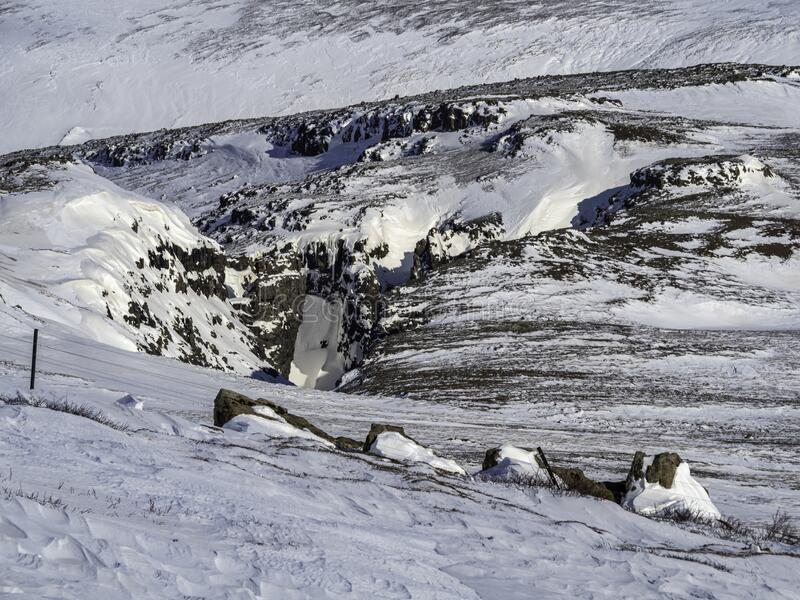Kaldakvísl on snæfellsnes in Iceland. Crack full of snow and ice royalty free stock image