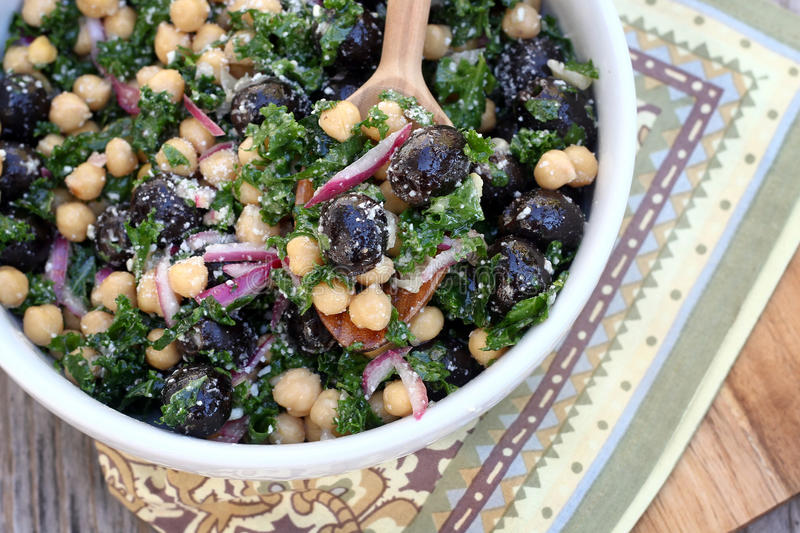Kale, Chickpea and Olive Salad. Kale salad with olive and chickpeas stock image