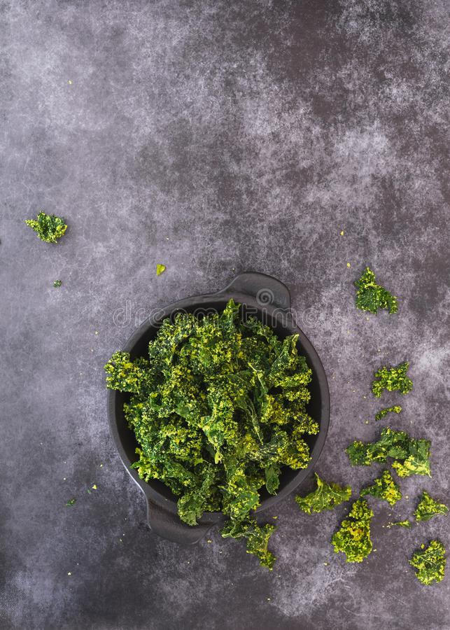 Kale chips in a bowl stock photography