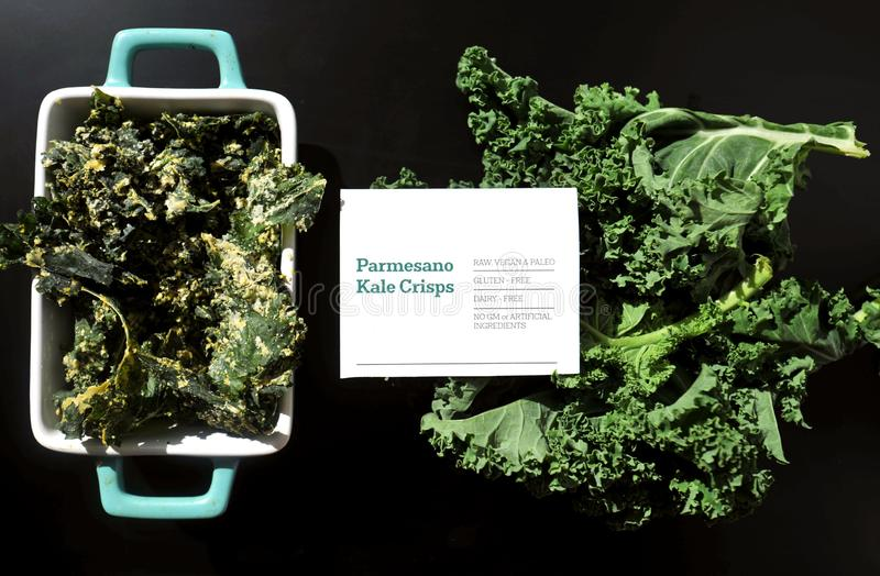 Kale chips with parmesan cheese, vegan paleo diet stock photography