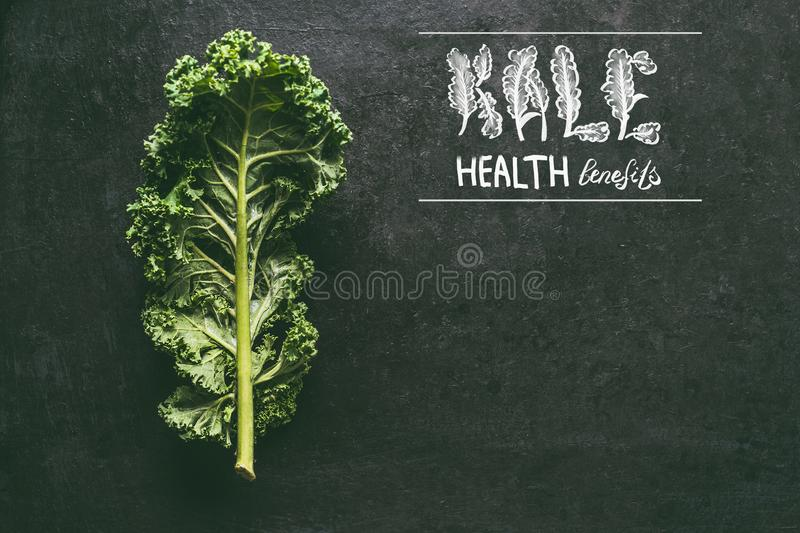Kale health benefits background with fresh kale leaf. Healthy detox vegetables . Clean eating and dieting concept. Top view with. Copy space. Text lettering stock photo