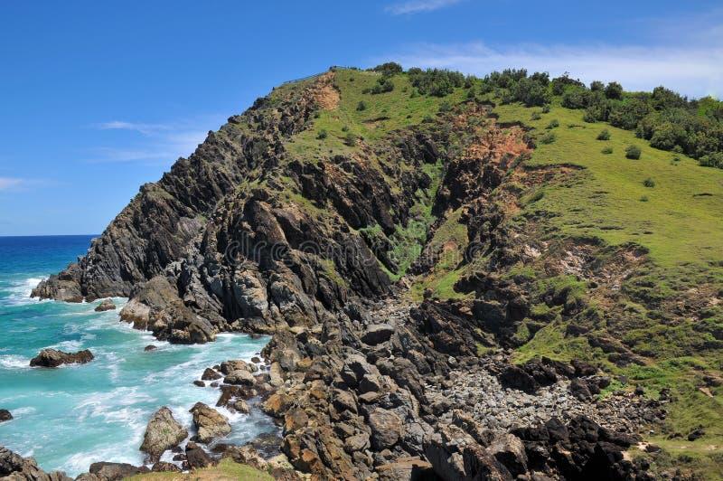 Kale rotsachtige landtong bij Baai Byron royalty-vrije stock fotografie